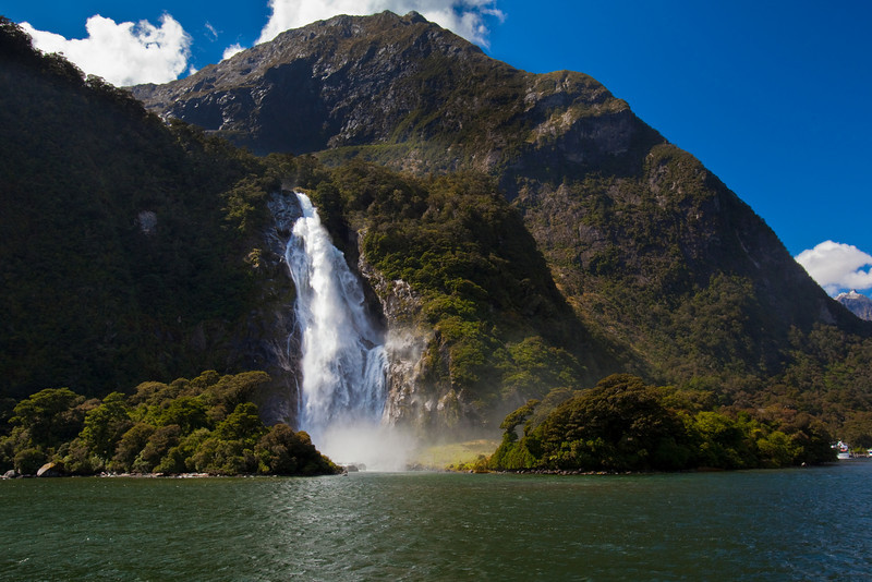 THE WATERFALL AT MILFORD SOUND, NEW ZEALAND